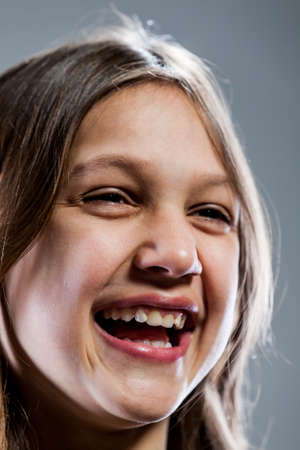 laughter: girl laughter caught in a close up portrait Stock Photo