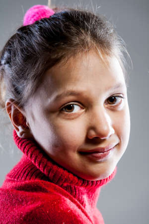 elementary age girl: red sweater little girl portrait (close up) Stock Photo