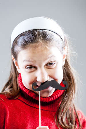 grimaces: girl making grimaces and funny faces with carton disguises
