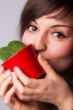 having fun in winter time: woman kissing her beloved plant