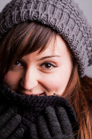 having fun in winter time: winter portrait of a happy woman with wool hat scarf and gloves Stock Photo