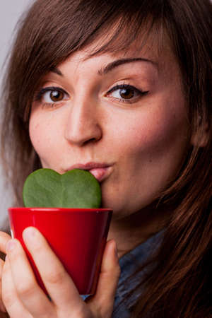 having fun in winter time: woman loving her plant and kissing