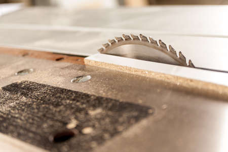 systematic: detail of a circular saw covered with sawdust Stock Photo