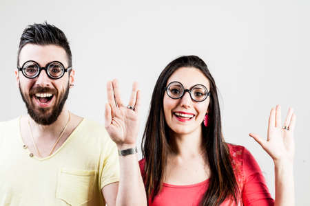 prosper: nerd man and nerd woman showing the live long and prosper salutation