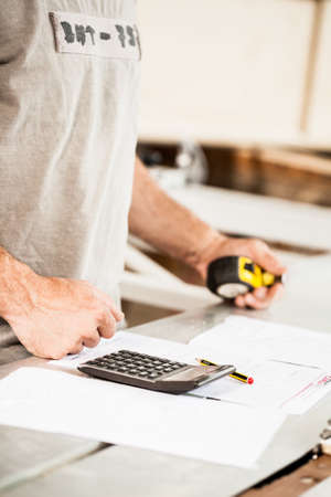 woodworker: woodworker hands with calculator pen and pencil Stock Photo