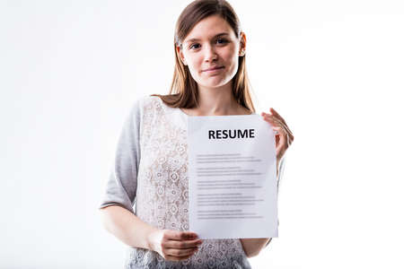 happy woman holding a resume on a white background