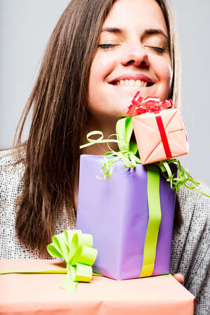 packets: delighted woman with colorful packets and gifts Stock Photo