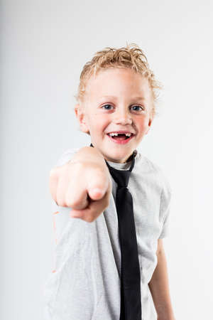 scoundrel: happy boy pointing out to you because he spotted you among the others Stock Photo