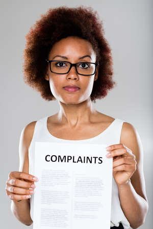 complaining: young woman complaining and disappointed with glasses Stock Photo