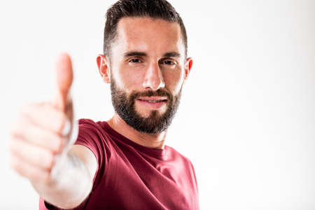 thumbs up man: thumbs up man with beard means success or approval
