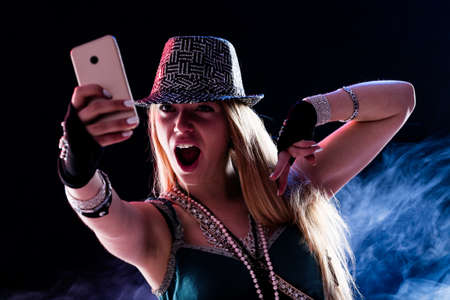 live event: young woman living a live event online using some internet connection or service via her smartphone and feeling as like as if she was really there