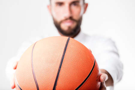 business metaphore: businessman passing the basket ball to you