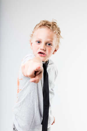 scoundrel: little kid pointing out to YOU because he choose you for the job Stock Photo