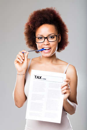 not a problem: taxes are not a problem for this young woman because shes an expert accountant Stock Photo
