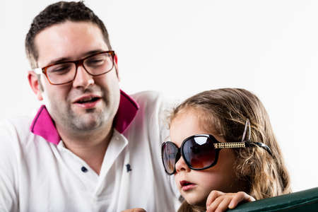 pretender: little daughter plays the Star role talking to her manager about what to do Stock Photo