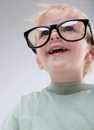 child looking up: little child looking up right with a very big pair of glasses