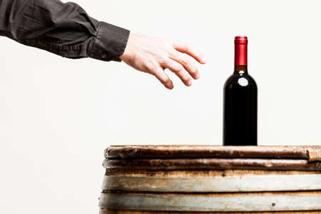 grasp: male hand about to grasp a wine bottle