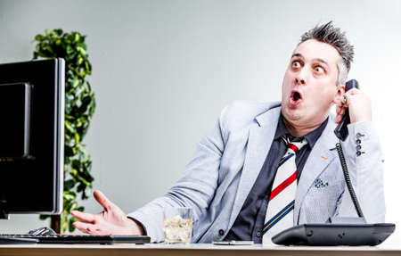 funny character of a shocked balls-eyed businessman and his mouth open