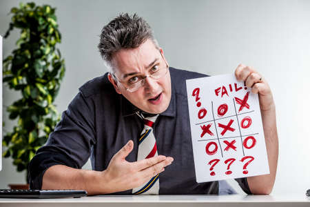 evident: office worker observing an evident error on a tic-tac-toe problem