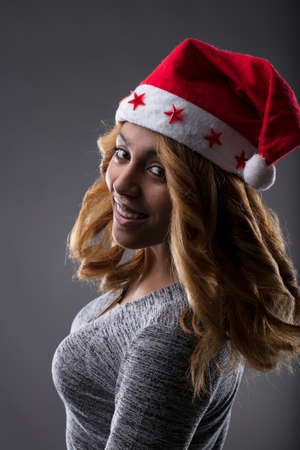 beautiful sexy Santa Claus disguised woman from behind and wishing you a merry Cristmas Stock Photo