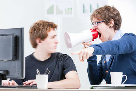 bossy: impolite coworker shouting to his colleague with a white and red megaphone in a bossy attitude