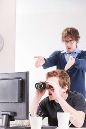 metaphoric: metaphoric image of a colleague surprised about his friend that couldnt view even if he uses binoculars to see