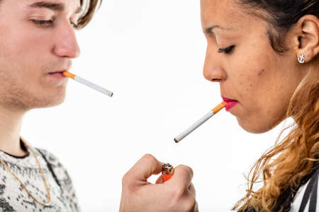boor: young man lightin a cigarette to a young woman