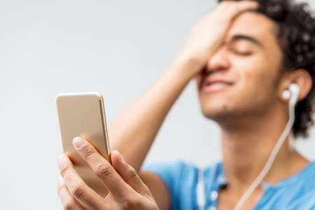 man receiving exciting news by mobile phone and maybe sexy news