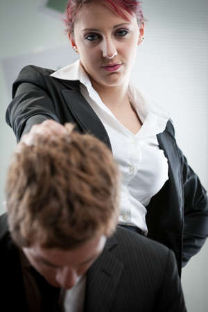 chagrin: concept of a woman humiliating a man on the workplace