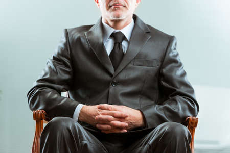 anonymous chairman on his chair in a business workplace
