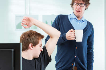 odour: office colleague disgusted by body odour in the workplace