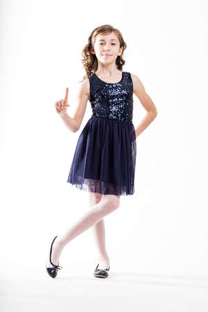 likeable: girl pretending to be a little fashion model talking herself up for a joke Stock Photo