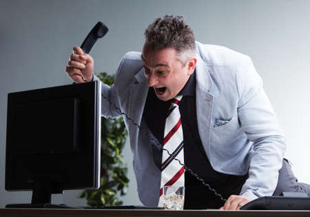 overbearing: angry boss about to destroy his pc monitor found guilty to be in the wrong place in the wrong moment