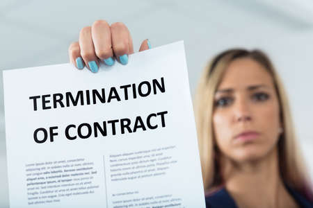aggressively: close up of a termination of contract letter aggressively imposed by a manager