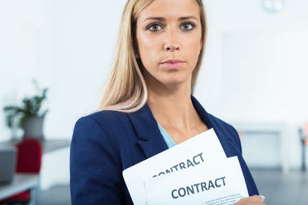 looking for job: proud and satisfied woman very pleased to have a pair of contracts