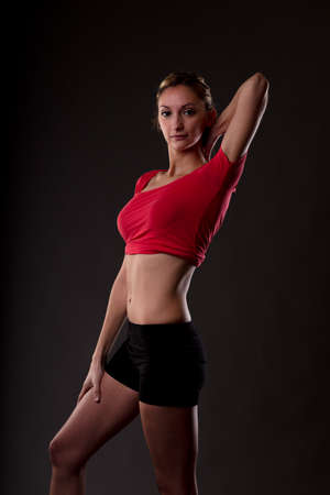natural woman in a very good shape showing her slim body and strong muscles