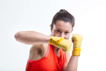 defend: woman practicing martial arts could defend herself and attack Stock Photo