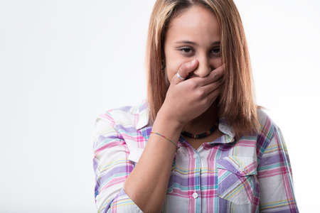 irresistible: girl restraining from an irresistible laughter Stock Photo