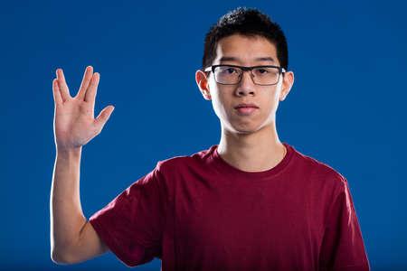 stigma: science fiction lover salutation sometimes looks like a nerd stigma, portrait of an asian descent fiction fan