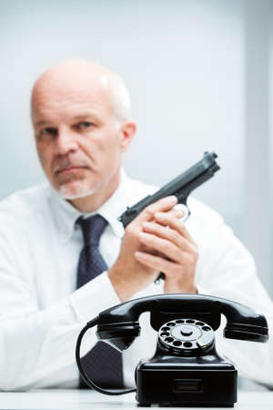 business metaphore: concept of an on-demand hired assassin on a contact us pose Stock Photo