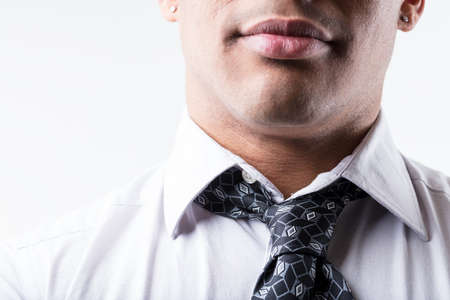 close up portrait of a neck, wearing an untied tie on a white shirt Stock Photo