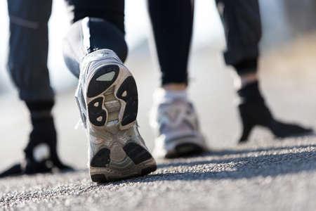 starting blocks: detail of shoes of an athlete simulating starting blocks on the street