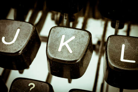 K letter closeup between other letters on an original vintage typewriters keyboard Stock Photo