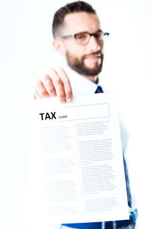 levy: tax officer or fiscal expert, seems to be too pleased to bring a tax form to you Stock Photo