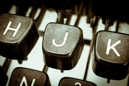 J letter closeup between other letters on an original vintage typewriters keyboard
