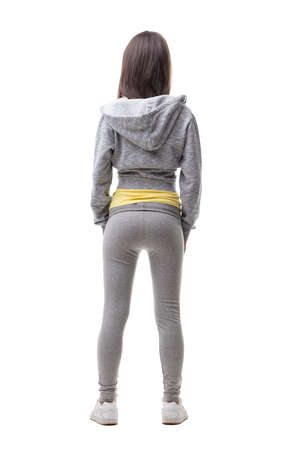 young woman on tracksuit seen from behind in a good shape ready for a workout or running