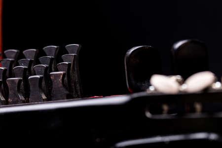 details of nyckelharpas keys on black background