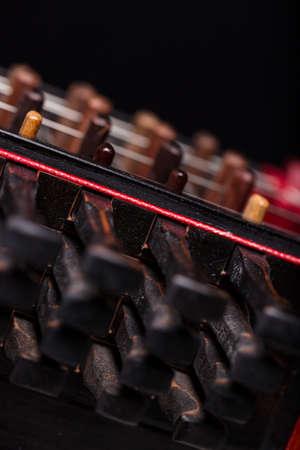 pegheads: details of nyckelharpas keys on black background