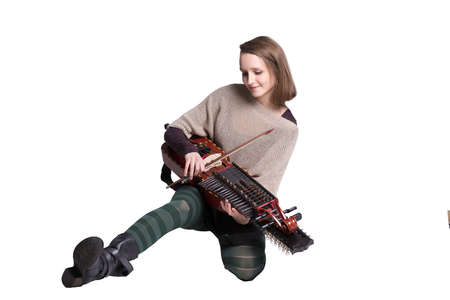 pegheads: woman with medieval or baroque musical instrument isolated on white; concept of folk music player