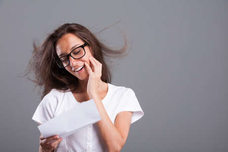 woman loves what shes reading on the letter shes reading and this is evident Stock Photo